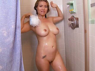 Busty blonde grown up Lucy Courier loves masturbating while showering